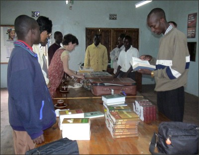 Students receiving books