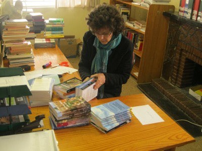 Cataloguing books donated to Dumisani library