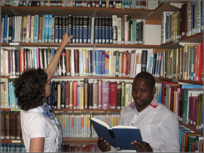 Nancy & Student in Dumisani Library